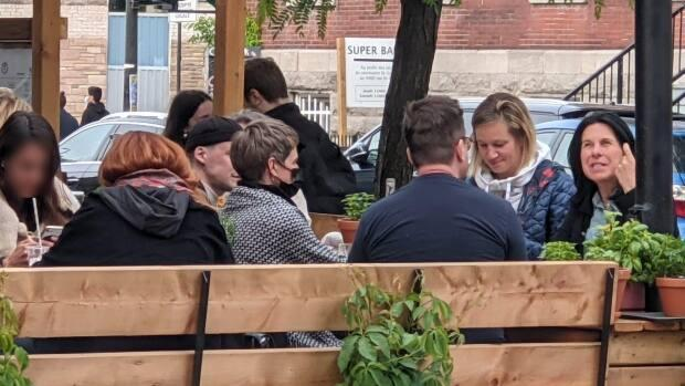 On Saturday, Plante admitted she had broken public health rules by sitting with five other people outside a restaurant. (Frederick Carle/Twitter - image credit)