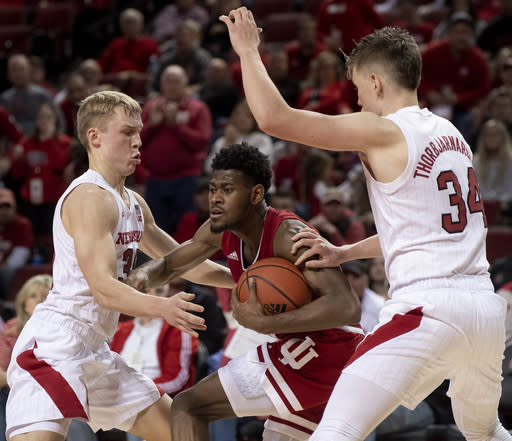 Indiana's Aljami Durham (1) is double-teamed by Nebraska guards Charlie Easley (30) and Thorir Thorbjarnarson (34) late in the second half of an NCAA college basketball game Saturday, Jan. 18, 2020, in Lincoln, Neb. (Francis Gardler/Lincoln Journal Star via AP)