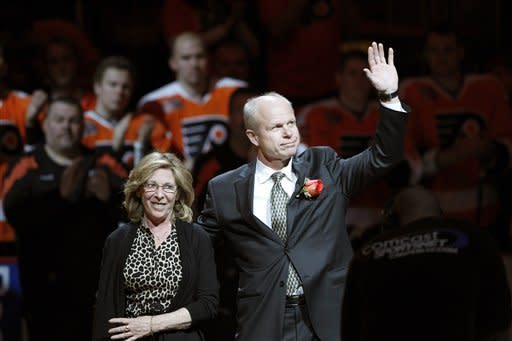 Mark Howe, right, and his wife, Ginger Howe, arrive for a ceremony to retire Howe's No. 2 jersey, before an NHL hockey between the Philadelphia Flyers and the Detroit Red Wings on Tuesday, March 6, 2012 in Philadelphia. (AP Photo/Alex Brandon)