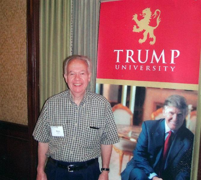 "In this undated photo provided by Bob Guillo, Guillo poses with a cardboard of millionaire/Reality TV Star Donald Trump in New York. Guillo paid $35 thousand to attend a Trump University seminar but never got to meet Trump in person. New York Attorney General Eric Schneiderman filed a $40 million lawsuit against the billionaire developer and his ""Trump University."" (AP Photo)"