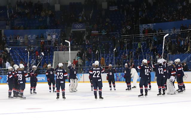 SOCHI, RUSSIA - FEBRUARY 08: The United States celebrate after defeating Finland 3 to1 in their Women's Ice Hockey Preliminary Round Group A Game on day 1 of the Sochi 2014 Winter Olympics at Shayba Arena on February 8, 2014 in Sochi, Russia. (Photo by Bruce Bennett/Getty Images)