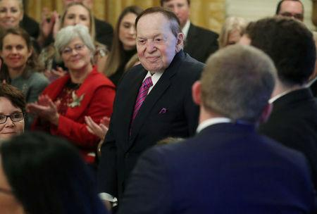 FILE PHOTO: Casino magnate Adelson attends ceremony as his wife Miriam is awarded a 2018 Presidential Medal of Freedom at the White House in Washington