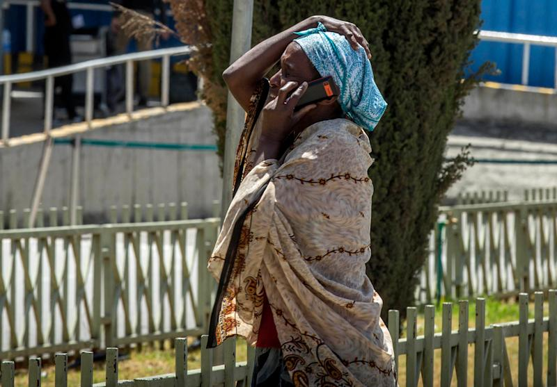 A family member of a victim involved in a plane crash talks on a mobile phone at Addis Ababa international airport, March 10, 2019. (Photo: Mulugeta Ayene/AP)