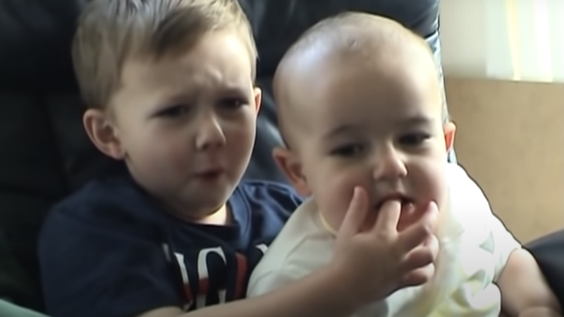 It's unclear what he expected to happen when he put his finger in his brother's mouth.