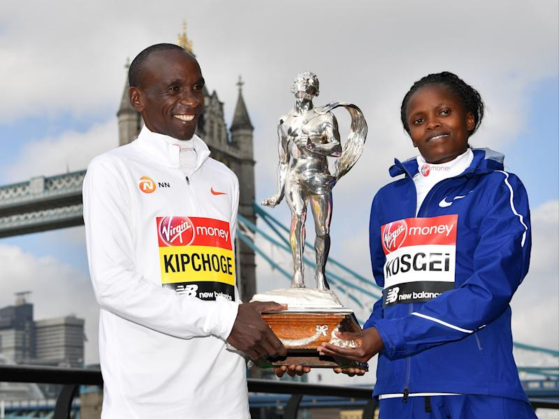 Last year's men's and women's winners: Eliud Kipchoge and Brigid KosgeiAFP via Getty Images
