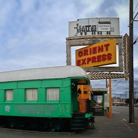 <p>The old railcars in Seattle's SoDo neighborhood just looks haunted don't they? They serve Thai and Chinese food there, but more importantly, strong drinks. According to reports lights have exploded several times inside thanks to a pissed off spirit that wanders the bar. <i>Photo by Bruch Fleming</i><br></p>