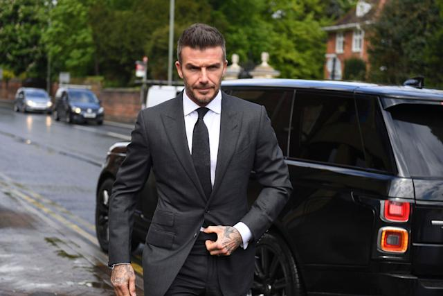David Beckham enters court on Thursday, where he lost his driver's license for six months. (Victoria Jones/PA via AP)