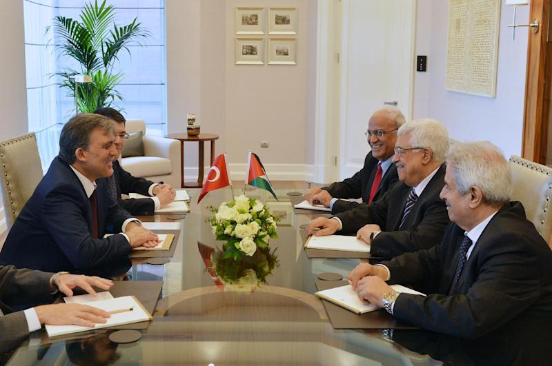 In this photo provided by Turkish Presidency Press Service,Turkey's President Abdullah Gul, left, and Palestinian leader Mahmoud Abbas, second right, seen during a meeting in Ankara, Turkey, Monday, April 22, 2013. U.S. Secretary of State John Kerry met with Abbas Sunday in Istanbul, in an effort to relaunch Mideast peace efforts, one of President Barack Obama's foreign policy priorities.(AP Photo/irfan Yildiz)