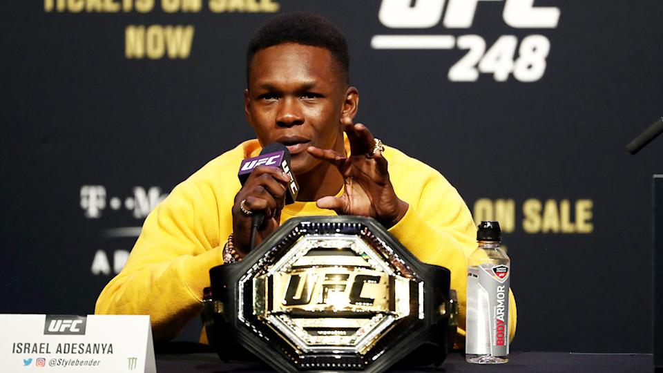 Pictured here, Israel Adesanya has been slammed over a reference to the terror attack on the Twin Towers.