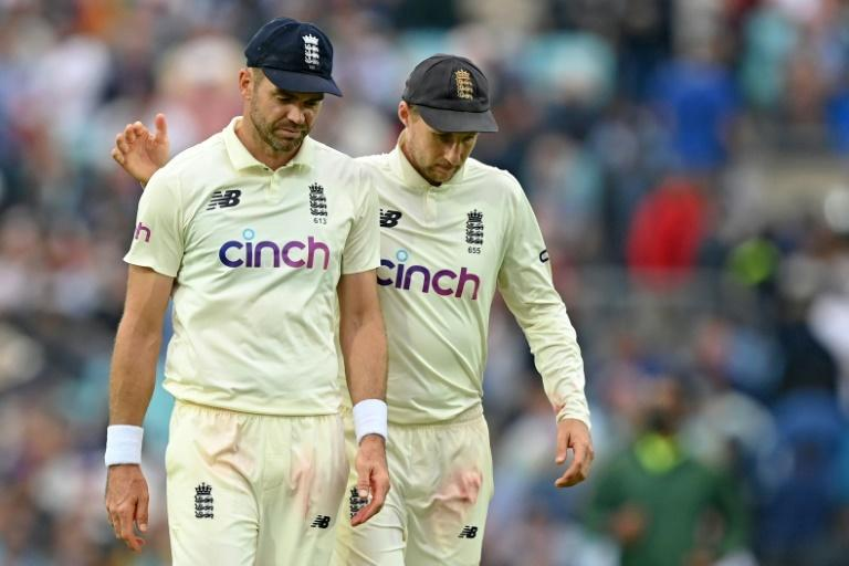 Cause for concern: England captain Joe Root (right) wants to manage the workload of bowling James Anderson (left) (AFP/DANIEL LEAL-OLIVAS)