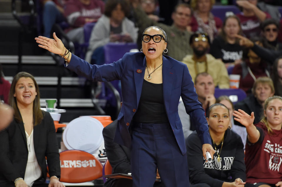 South Carolina head coach Dawn Staley gestures during the second half of an NCAA college basketball game against Clemson, Sunday, Nov. 24, 2019, in Clemson, S.C. (AP Photo/Richard Shiro)