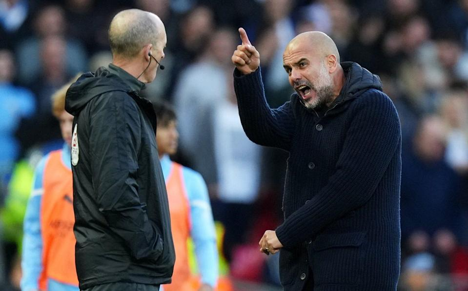 Pep Guardiola remonstrates with the fourth official - GETTY IMAGES