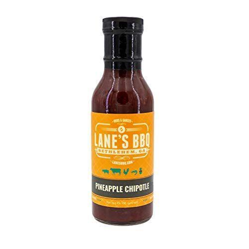 """<p><strong>Lane's BBQ</strong></p><p>amazon.com</p><p><strong>$15.99</strong></p><p><a href=""""https://www.amazon.com/dp/B08HNBKK61?tag=syn-yahoo-20&ascsubtag=%5Bartid%7C10055.g.36232085%5Bsrc%7Cyahoo-us"""" rel=""""nofollow noopener"""" target=""""_blank"""" data-ylk=""""slk:Shop Now"""" class=""""link rapid-noclick-resp"""">Shop Now</a></p><p>This delicious bottle, with a short and clean ingredient list, packs a seriously fresh pineapple flavor into each bite with a smoky chipotle finish. </p>"""