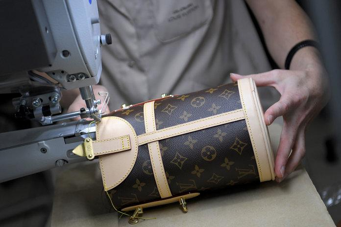 A craftwoman works on a chest on October 12, 2018 at the Louis Vuitton leather work factory in Juilley, western France.   LOIC VENANCE/Getty Images