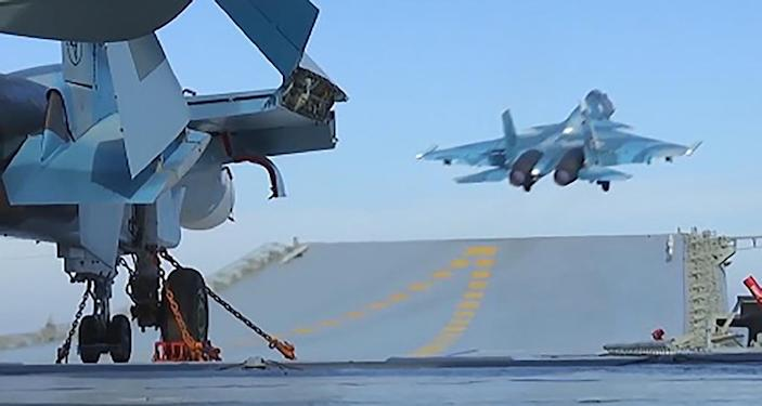 An image from video footage made available on the Russian defence ministry website on November 15, 2016, reportedly shows a jet taking off from the Admiral Kuznetsov aircraft carrier in the Mediterranean off Syria (AFP Photo/HO)