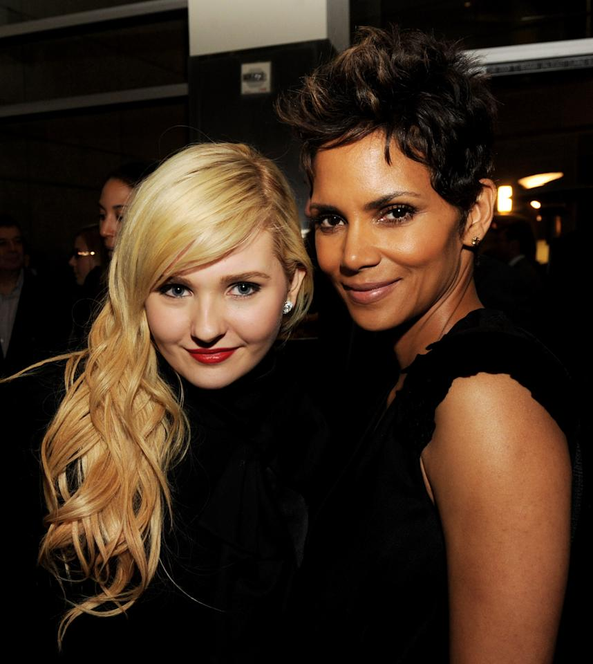 "LOS ANGELES, CA - MARCH 05:  Actresses Abigail Breslin (L) and Halle Berry pose at the after party for the premiere of Tri Star Pictures' ""The Call"" at the Arclight Theatre on March 5, 2013 in Los Angeles, California.  (Photo by Kevin Winter/Getty Images)"
