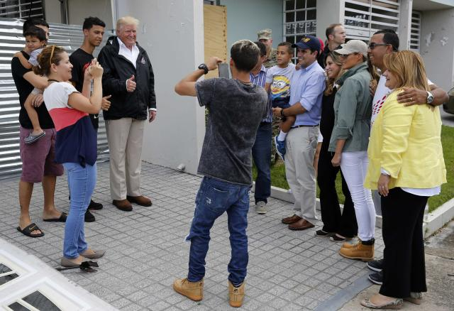 <p>President Donald Trump poses for a photo with residents while visiting Puerto Rico to survey relief efforts following Hurricane Maria in Guaynabo, Puerto Rico, Oct. 3, 2017. (Photo: Jonathan Ernst/Reuters) </p>