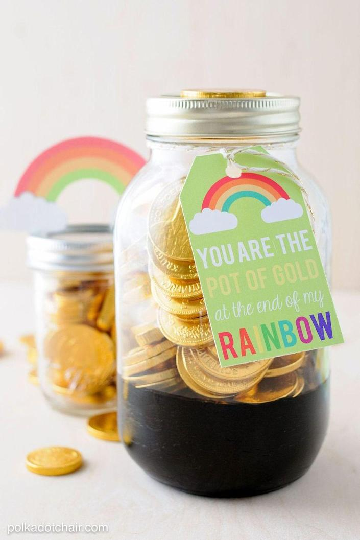 """<p>Add chocolate coins to these Mason jars, then drop them off to all your neighbors. It's such an easy way to spread love.</p><p><strong>Get the tutorial at <a href=""""https://www.polkadotchair.com/pot-gold-mason-jar-gift-idea/"""" rel=""""nofollow noopener"""" target=""""_blank"""" data-ylk=""""slk:Polka Dot Chair"""" class=""""link rapid-noclick-resp"""">Polka Dot Chair</a>.</strong></p><p><a class=""""link rapid-noclick-resp"""" href=""""https://go.redirectingat.com?id=74968X1596630&url=https%3A%2F%2Fwww.walmart.com%2Fsearch%2F%3Fquery%3Dmason%2Bjars&sref=https%3A%2F%2Fwww.thepioneerwoman.com%2Fhome-lifestyle%2Fcrafts-diy%2Fg35012898%2Fst-patricks-day-crafts%2F"""" rel=""""nofollow noopener"""" target=""""_blank"""" data-ylk=""""slk:SHOP MASON JARS"""">SHOP MASON JARS</a></p>"""
