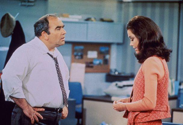 PHOTO: Actors Edward Asner, as Lou Grant, and Mary Tyler Moore, as Mary Richards, in a scene from 'The Mary Tyler Moore Show' in 1970, Los Angeles.  (CBS Photo Archive via Getty Images)