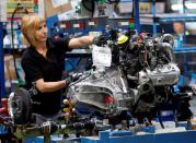 FILE PHOTO: A Nissan Motor staff works on an engine in the assembly line at the Zona Franca Nissan factory near Barcelona