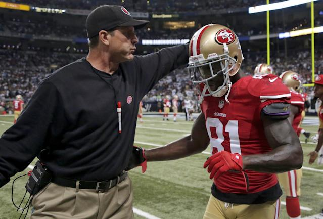 San Francisco 49ers wide receiver Anquan Boldin, right, is congratulated by coach Jim Harbaugh after a 20-yard touchdown reception during the second quarter of an NFL football game against the St. Louis Rams on Thursday, Sept. 26, 2013, in St. Louis. (AP Photo/Charlie Riedel)