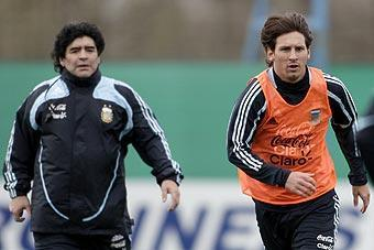 Diego Maradona (left) and Lionel Messi take part in a training session in Buenos Aires