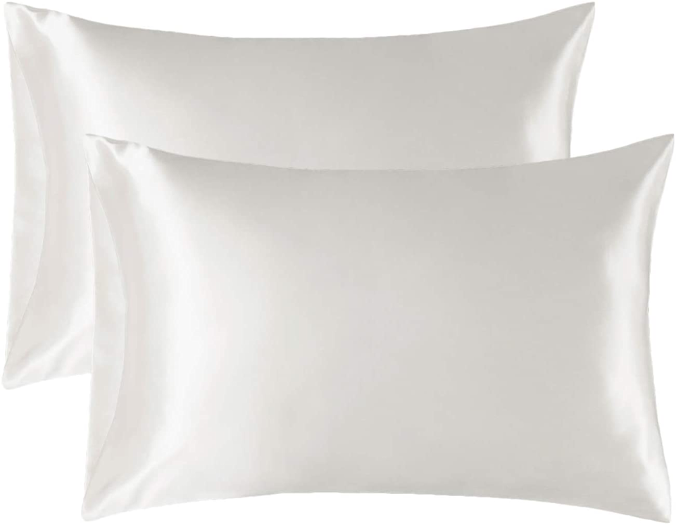 """<h3><a href=""""https://amzn.to/355fhZ9"""" rel=""""nofollow noopener"""" target=""""_blank"""" data-ylk=""""slk:Satin Pillowcases"""" class=""""link rapid-noclick-resp"""">Satin Pillowcases</a></h3><br><strong>Emerson</strong><br><br><strong>How She Discovered It:</strong> """"I had heard sleeping on cotton is really bad for your skin and hair, so I've always wanted satin or silk pillowcases, but haven't been up for spending $50+ for just one!""""<br><br><strong>Why It's A Hidden Gem:</strong> """"Because of the price point, I was iffy about how these would feel IRL, but they are so smooth and buttery and make me feel like I'm sleeping at a 5-star hotel. I've also noticed a huge difference in my hair, it's way less frizzy when I wake up in the morning and my style is still intact from the day before. They come in so many colors so I'm definitely ordering a few more to mix and match.""""<br><br><br><strong>Bedsure</strong> Satin Pillowcase for Hair and Skin, 2 Pack, $, available at <a href=""""https://amzn.to/355fhZ9"""" rel=""""nofollow noopener"""" target=""""_blank"""" data-ylk=""""slk:Amazon"""" class=""""link rapid-noclick-resp"""">Amazon</a>"""