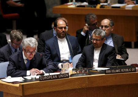 FILE PHOTO: EU representative to United Nations Mayr-Harting speaks as Iranian UN envoy, Khoshroo looks on  during U.N. Security Council meeting at U.N. headquarters in New York