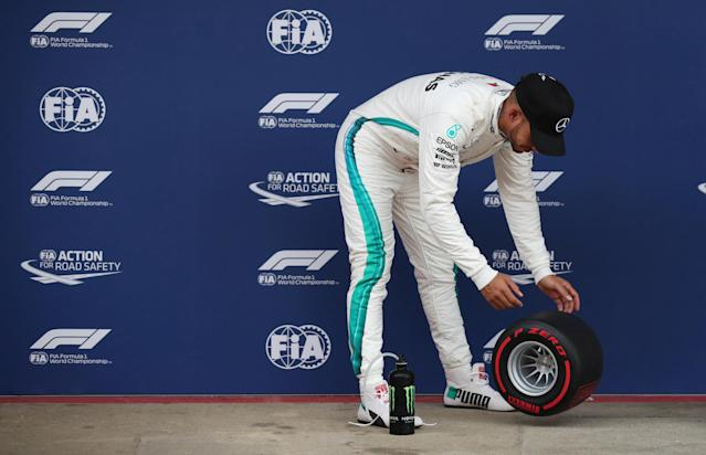 Formula One F1 - Spanish Grand Prix - Circuit de Barcelona-Catalunya, Barcelona, Spain - May 12, 2018 Mercedes' Lewis Hamilton celebrates pole position with an award after qualifying REUTERS/Albert Gea
