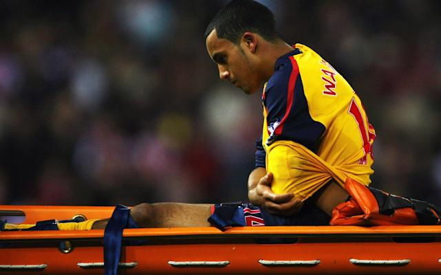 <span>Theo Walcott of Arsenal is stretchered off injured at the Britannia Stadium in 2008 </span>