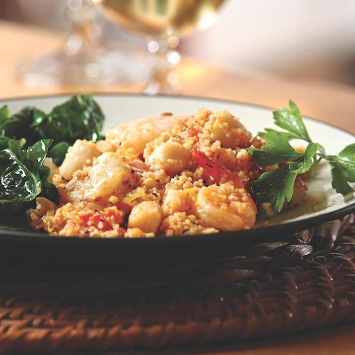 <p>Whole-wheat couscous soaks up this savory saffron-infused broth.</p>