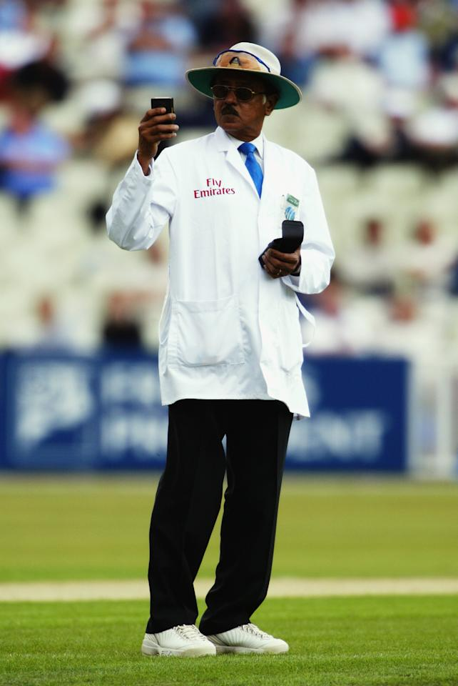 BIRMINGHAM - JULY 24:  Umpire Venkat checks the light during the first day of the first npower test match between England and South Africa held on July 24, 2003 at the Edgbaston Cricket Ground, in Birmingham, England. (Photo by Tom Shaw/Getty Images)