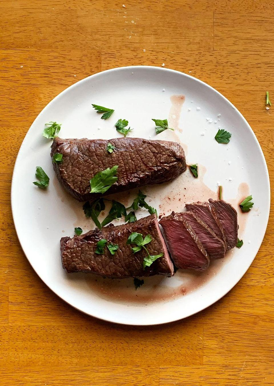 """<p>Steak is one of those dinners that manage to be both easy and decadent. And with an air fryer, it's faster than an oven, and far less messy than a frying pan. </p><p><strong><a href=""""https://www.countryliving.com/food-drinks/a35462011/air-fryer-steak/"""" rel=""""nofollow noopener"""" target=""""_blank"""" data-ylk=""""slk:Get the recipe"""" class=""""link rapid-noclick-resp"""">Get the recipe</a>.</strong> </p>"""