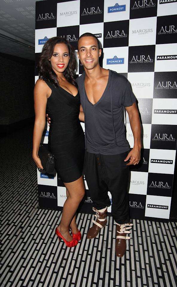 Rochelle and Marvin Humes photos: Rochelle and Marvin posed for photographers at a party in 2010. We can't work out who's wearing the lower-cut neckline! Copyright [WENN]
