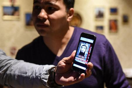 Amir Ganiev, age 27, looks at a picture of Sayfullo Saipov, the Uzbek suspect in the deadly truck attack while working in an Uzbek restaurant in the borough of Brooklyn in New York City, U.S., November 1, 2017. REUTERS/Stephanie Keith