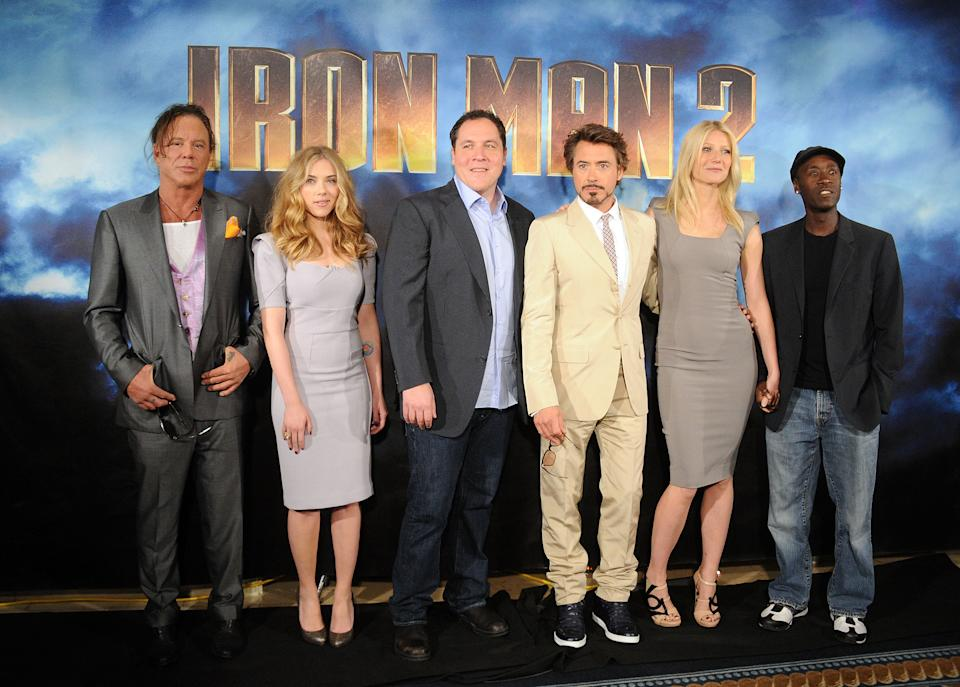 """LOS ANGELES, CA - APRIL 23:  (L-R) Actors Mickey Rourke, Scarlett Johansson, director/actor Jon Favreau, actor Robert Downey Jr., actress Gwyneth Paltrow, and actor Don Cheadle pose during Paramount Pictures & Marvel Entertainment's """"Iron Man 2"""" photo call held at the Four Seasons Hotel on April 23, 2010 in Los Angeles, California.  (Photo by Jason Merritt/Getty Images)"""