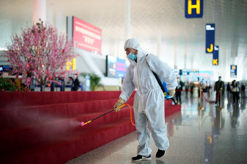 Worker in protective suit disinfects the Wuhan Tianhe International Airport