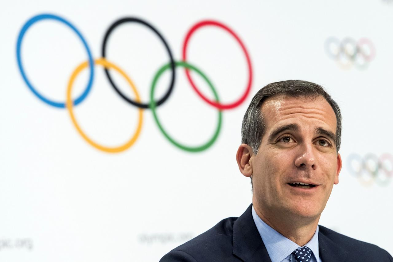<p>FILE – In this July 11, 2017 file photo Mayor of Los Angeles Eric Garcetti speaks, during a press conference after the International Olympic Committee (IOC) Extraordinary Session, at the SwissTech Convention Centre, in Lausanne, Switzerland. It was announced Monday, July 31, 2017 that Los Angeles has reached an agreement with international Olympic leaders that will open the way for the city to host the 2028 Summer Games, while ceding the 2024 Games to rival Paris. (Jean-Christophe Bott/Keystone via AP, File) </p>
