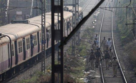 Policemen patrol on tracks at a suburban railway station in Mumbai, India, January 3, 2018. REUTERS/Danish Siddiqui