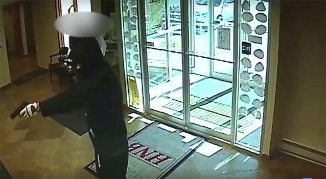 The armed robber demanded cash.