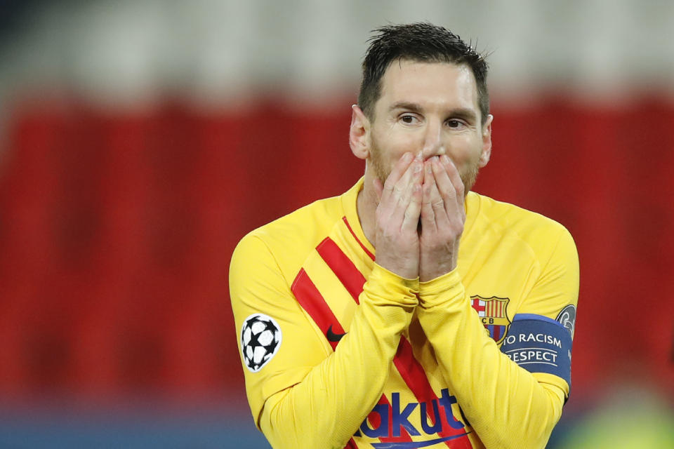 Barcelona's Lionel Messi reacts after a missed a penalty shot during the Champions League, round of 16, second leg soccer match between Paris Saint-Germain and FC Barcelona at the Parc des Princes stadium in Paris on Wednesday, March 10, 2021. Neither Messi nor Cristiano Ronaldo will be in the Champions League quarterfinals for the first time since 2005. The two greatest players of the current generation were both eliminated from the competition this week. Messi scored a goal but missed a penalty as Barcelona was eliminated by Paris Saint-Germain. Ronaldo and his Juventus teammates were ousted by Porto the night before. Ronaldo has won five Champions League titles in his career. Messi has won four. (AP Photo/Christophe Ena)