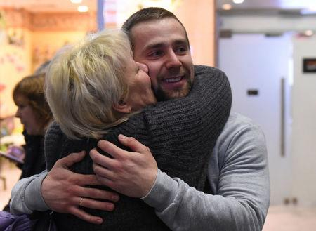 Russian Olympic curler Alexander Krushelnitsky is welcomed upon his return from the Pyeongchang 2018 Winter Olympics, at Pulkovo airport outside St. Petersburg, Russia February 22, 2018. REUTERS/Sergei Nikolaev