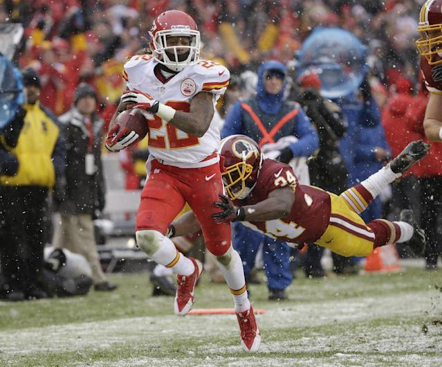 Kansas City Chiefs wide receiver Dexter McCluster breaks free from Washington Redskins defensive back Trenton Robinson to score a touchdown on a punt return during the first half of an NFL football game in Landover, Md., Sunday, Dec. 8, 2013. (AP Photo/Pablo Martinez Monsivais)