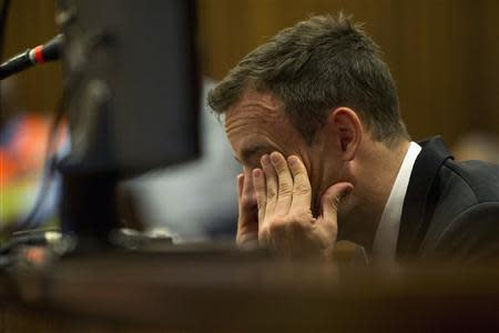 Oscar Pistorius reacts during his trial at the high court in Pretoria April 7, 2014. REUTERS/Deaan Vivier/Pool