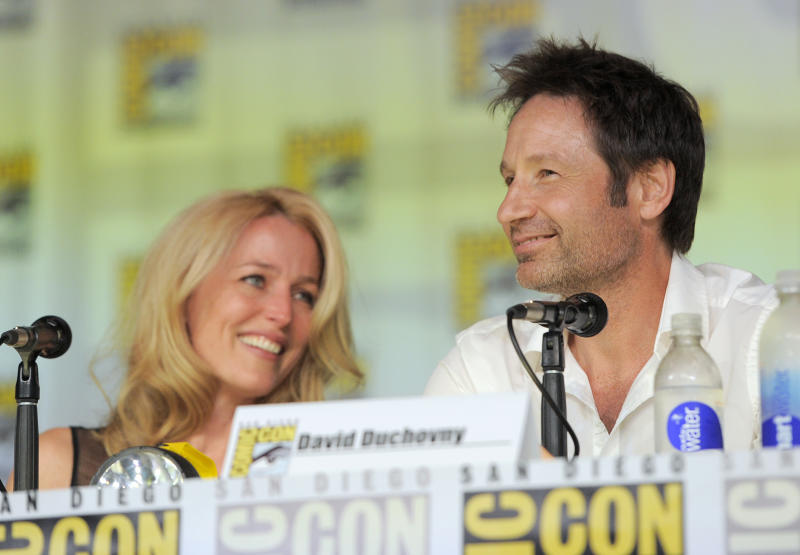 """Gillian Anderson, left, and David Duchovny, attend the """"The X Files"""" 20th Anniversary panel on Day 2 of Comic-Con International on Thursday, July 18, 2013 in San Diego, Calif. (Photo by Chris Pizzello/Invision/AP)"""