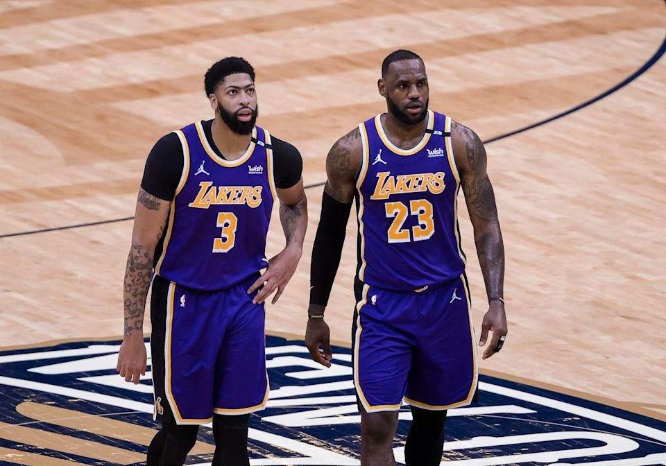 Anthony Davis (left) and LeBron James (right) will be key to the Lakers' matchup against the Warriors.
