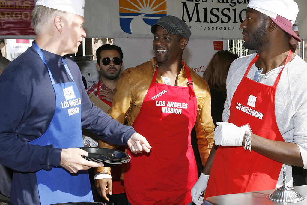 Celebrities come out to help feed the needy at the LA Mission in downtown LA. Pictured: Blair Underwood  Ref: SPL461884  211112  Picture by: PhamousFotos / Splash News   Splash News and Pictures Los Angeles:310-821-2666 New York:212-619-2666 London:870-934-2666 photodesk@splashnews.com