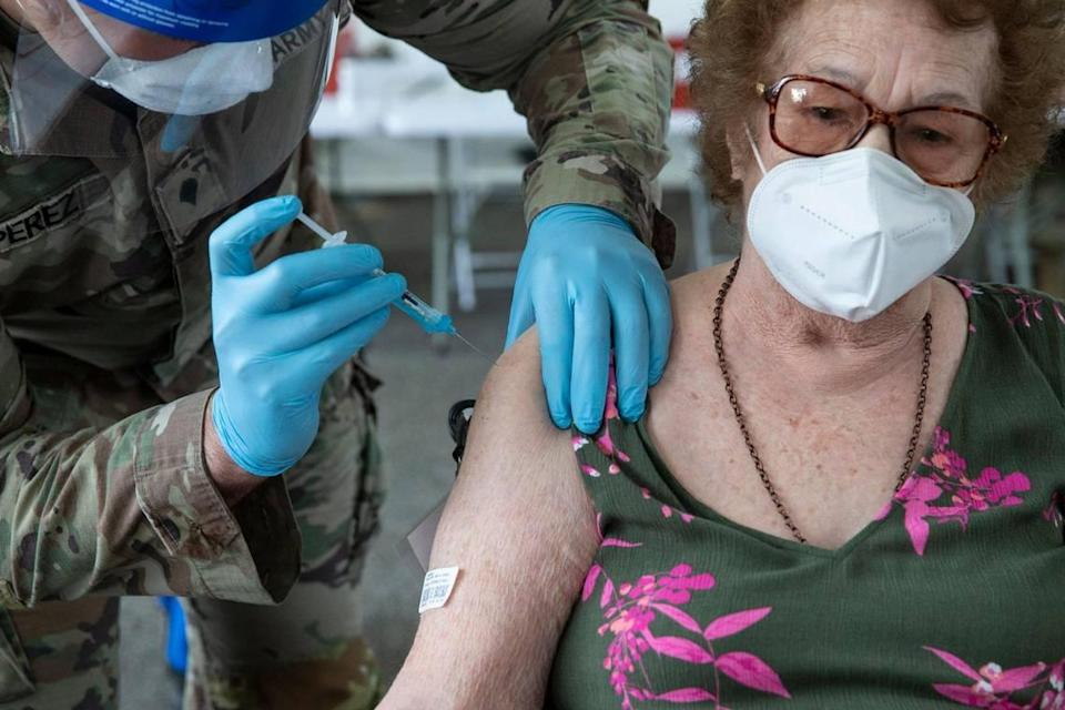 Loida Mendez, 86, is injected with Pfizers COVID-19 vaccine during opening day at the FEMA vaccination site on Miami-Dade College's North Campus on Wednesday, March 3, 2021.