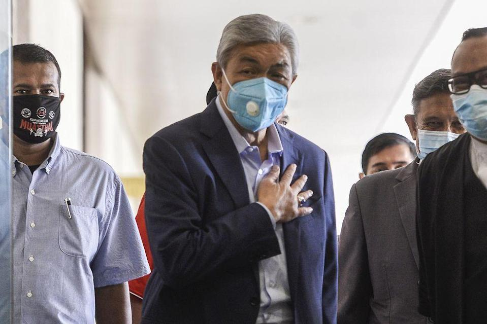 Datuk Seri Ahmad Zahid Hamidi (centre) is pictured at the Kuala Lumpur High Court June 16, 2020. — Picture by Miera Zulyana