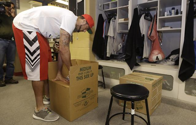 San Francisco 49ers quarterback Colin Kaepernick packs belongings from his locker at an NFL training facility in Santa Clara, Calif., Monday, Jan. 20, 2014. The 49ers lost to the Seattle Seahawks in the NFC Championship Game. (AP Photo/Jeff Chiu)
